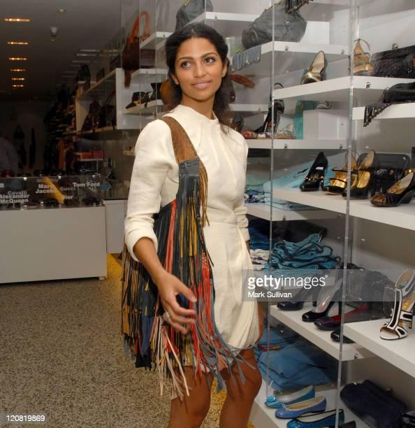 Model/designer Camila Alves poses with a handbag at the launch of Camila Alves' handbag collection MUXO at Kitson Studio on August 7, 2008 in Los...