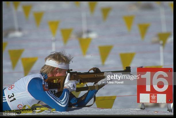 SERGEI CHEPIKOV OF THE SOVIET UNION PREPARES TO FIRE A SHOT DURING THE MENS 10 KM BIATHLON AT THE 1988 WINTER OLYMPICS HELD IN CALGARY CHEPIKOV WON...