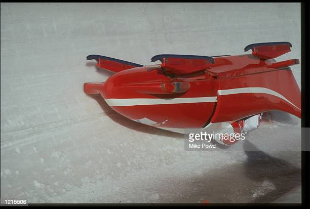 T SAKAI AND N TAKEWAKI CRASH DURING THE TWO MAN BOBSLEIGH COMPETITION AT THE 1988 WINTER OLYMPICS HELD IN CALGARY