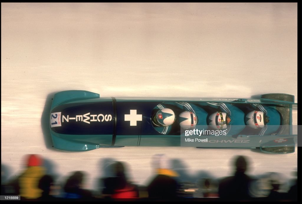 EKKEHARD FASSER (DRIVER), KURT MEIER , MARCEL FASSLER , AND WERNER STOCKER COMPETING IN THE 4 MAN BOBSLEIGH COMPETITION FOR THE SWITZERLAND I TEAM AT THE 1988 WINTER OLYMPICS HELD IN CALGARY. SWITZERLAND I WON THE GOLD MEDAL WITH A TOTAL TIME OF 3:47.51 MINUTES.