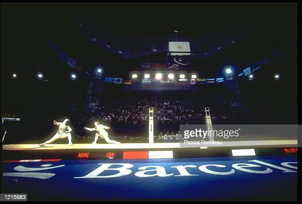 WANG HUIFENG OF CHINA AND FIONA JANE MCINTOSH OF GREAT BRITAIN IN ACTION DURING THEIR FENCING BOUT AT THE 1992 BARCELONA OLYMPICS HUIFENG WON THE...