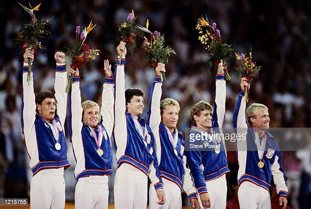 THE UNITED STATES TEAM CELEBRATE AFTER RECEIVING THEIR GOLD MEDALS FOR THEIR VICTORY IN THE MENS TEAM GYMNASTICS COMPETITION AT THE 1984 LOS ANGELES...