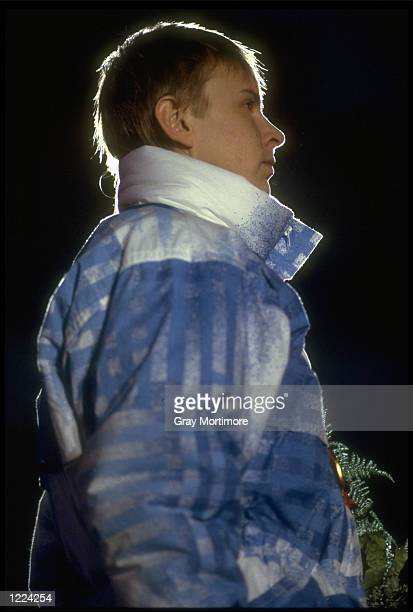 MATTI NYKANEN OF FINLAND LISTENS TO THE NATIONAL ANTHEM AFTER CLAIMING THE GOLD MEDAL IN THE MENS 70 METRE SKIJUMPING COMPETITION AT THE 1988 WINTER...