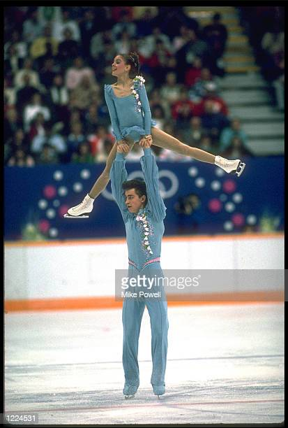 YEKATERINA GORDEYEVA AND SERGEI GRINKOV OF THE SOVIET UNION PERFORM THEIR ROUTINE IN THE FIGURE SKATING PAIRS COMPETITION AT THE 1988 WINTER OLYMPICS...
