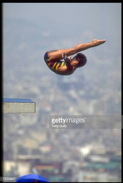 MINGXIA FU OF CHINA PERFORMS ONE OF HER DIVES DURING THE WOMENS 10 METRE PLATFORM DIVING COMPETITION AT THE 1992 BARCELONA OLYMPICS