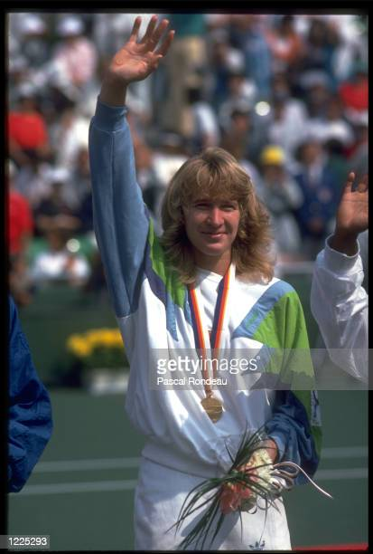 STEFFI GRAF OF WEST GERMANY WAVES TO THE CROWD AFTER RECEIVING HER GOLD MEDAL IN THE WOMENS SINGLES TENNIS COMPETITION AT THE 1988 SEOUL OLYMPICS...