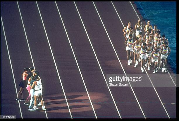 ATHLETES RUN THROUGH THE STADIUM DURING THE CLOSING CEREMONY OF THE 1992 BARCELONA OLYMPICS