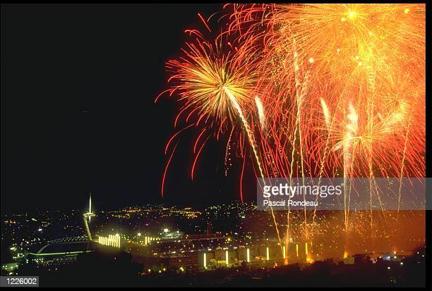 FIREWORKS EXPLODE HIGH ABOVE THE OLYMPIC STADIUM DURING THE CLOSING CEREMONY OF THE 1992 OLYMPICS HELD IN BARCELONA