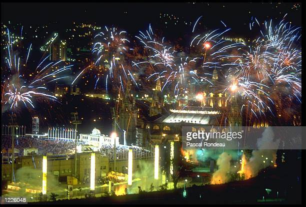 A FIREWORKS DISPLAY IS SET OFF ABOVE THE OLYMPIC STADIUM DURING THE COLSING CEREMONY OF THE 1992 BARCELONA OLYMPICS