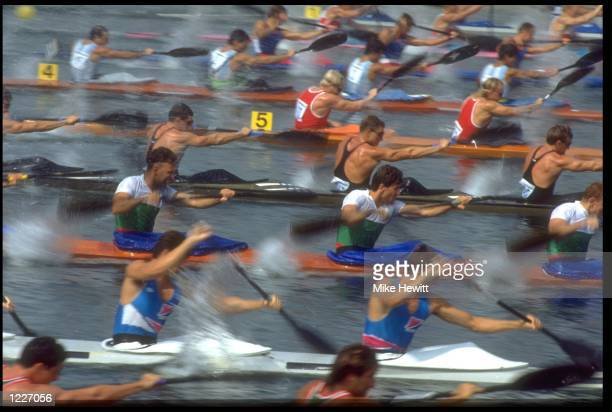 THE TEAMS POWER THEIR WAY DOWN THE COURSE DURING A QUALIFYING HEAT OF THE MENS K4 1000M FLATWATER COMPETITION AT THE 1992 BARCELONA OLYMPICS
