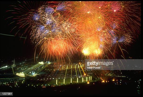 FIREWORKS EXPLODE HIGH ABOVE THE OLYMPIC STADIUM DURING THE OPENING CEREMONY OF THE 1992 BARCELONA OLYMPICS