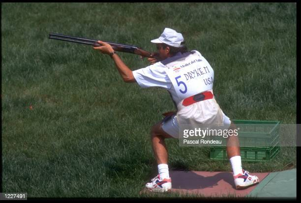 MATTHEW DRYKE OF THE UNITED STATES PREPARES TO FIRE A SHOT DURING THE OPEN SKEET SHOOTING COMPETITION AT THE 1992 BARCELONA OLYMPICS