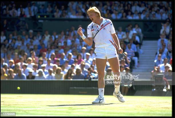 BORIS BECKER OF WEST GERMANY CELEBRATES AFTER WINNING A POINT DURING A MATCH AT THE 1990 WIMBLEDON TENNIS CHAMPIONSHIPS