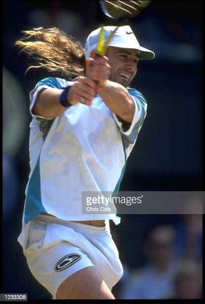 ANDRE AGASSI OF THE UNITED STATES PLAYS A TWO-HANDED BACKHAND DURING HIS QUARTER-FINAL MATCH AGAINST PETE SAMPRAS OF THE USA AT THE 1993 WIMBLEDON...