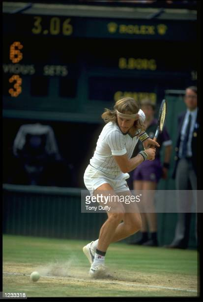 BJORN BORG OF SWEDEN PREPARES TO PLAY A LOW BACKHAND SHOT DURING A MATCH AT THE 1979 WIMBLEDON TENNIS CHAMPIONSHIPS.