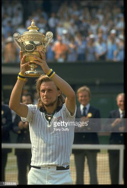 BJORN BORG OF SWEDEN LIFTS THE TROPHY ABOVE HIS HEAD AFTER WINNING THE 1976 WIMBLEDON TENNIS CHAMPIONSHIPS BORG DEFEATED ILIE NASTASIE OF ROMANIA 64...