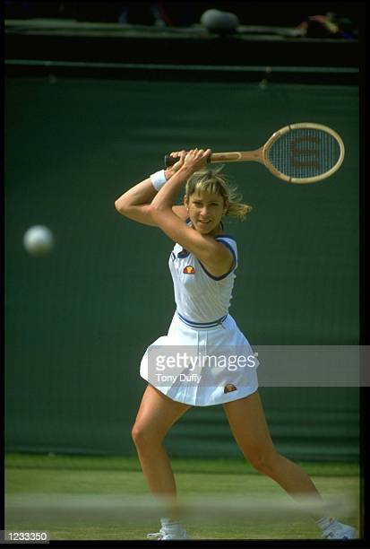 CHRIS EVERT OF THE UNITED STATES PLAYS A TWOHANDED BACKHAND DURING A MATCH AT THE 1982 WIMBLEDON TENNIS CHAMPIONSHIPS
