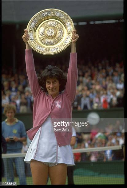 VIRGINIA WADE OF GREAT BRITAIN RAISES THE TROPHY ABOVE HER HEAD AFTER WINNING THE 1977 WIMBLEDON TENNIS CHAMPIONSHIPS. WADE DEFEATED BETTY STOVE OF...