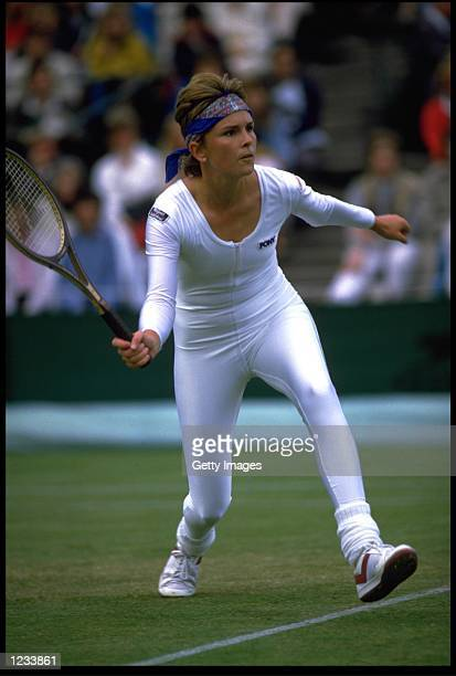 ANNE WHITE OF THE USA HITS A FOREHAND WHILST WEARING A REVOLUTIONARY ONE PIECE TENNIS OUTFIT AT THE WIMBLEDON CHAMPIONSHIPS