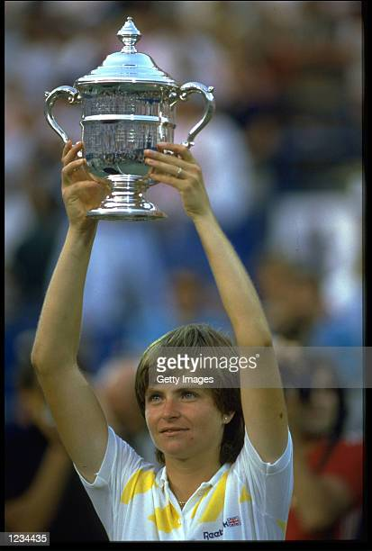 HANA MANDLIKOVA OF CZECHOSLOVAKIA HOLDS ALOFT THE US OPEN LADIES SINGLES TROPHY AFTER WINNING AT FLUSHING MEADOWS