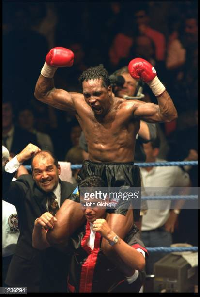 NIGEL BENN SITTING ON HIS TRAINERS SHOULDERS AND CELEBRATING AFTER WINNING HIS WBC SUPER MIDDLEWEIGHT WORLD TITLE AGAINST LOUIS GENT AT THE ROYAL...