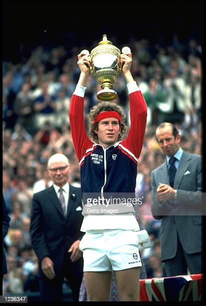 JOHN MCENROE OF THE UNITED STATES LIFTS THE TROPHY OVER HIS HEAD AFTER WINNING THE 1981 WIMBLEDON TENNIS CHAMPIONSHIPS.