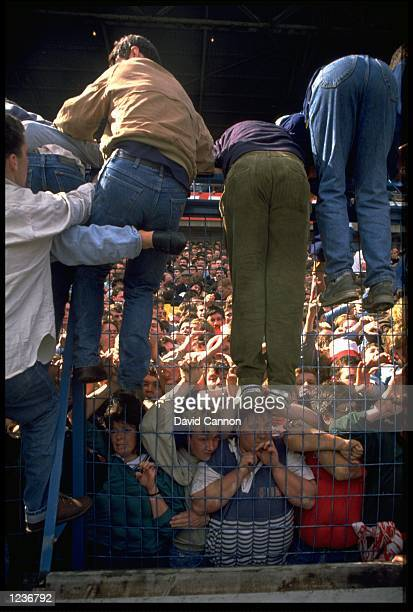 RESCUERS TRY TO PULL SUPPORTERS OUT OF THE LEPPINGS LANE TERRACING AT HILLSBOROUGH AFTER OVERCROWDING CAUSED A CRUSH 95 LIVERPOOL FANS WERE KILLED IN...