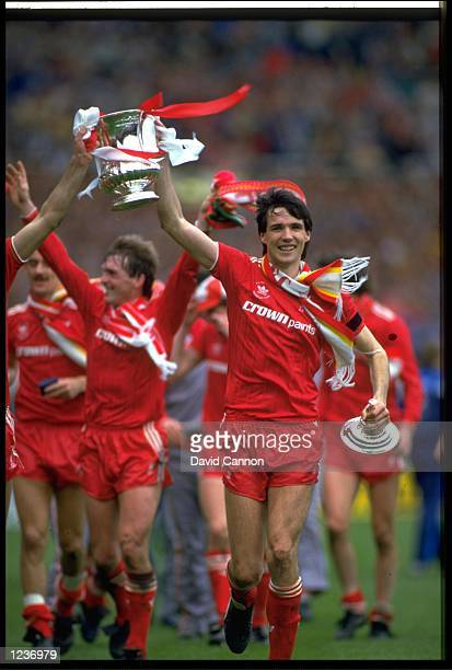 LIVERPOOL CAPTAIN ALAN HANSEN CELEBRATES WITH THE FA CUP AFTER LIVERPOOL HAD BEATEN EVERTON 3-1 IN THE FINAL AT WEMBLEY.