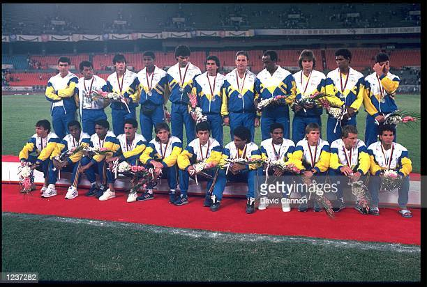 THE BRAZILIAN SOCCER TEAM LINE UP TO RECEIVE THEIR SILVER MEDALS AFTER LOSING TO THE USSR AT THE 1988 SEOUL SUMMER OLYMPICS