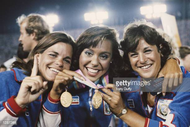 AFTER WINNING GOLD IN THE SYNCHRONIZED SWIMMING TRACY RUIZ OF THE UNITED STATES ENJOYS THE CLOSING CEREMONY OF THE 1984 LOS ANGELES OLYMPICS WITH HER...