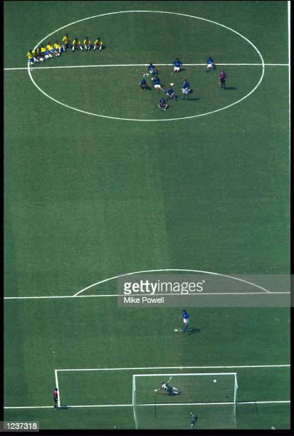 DEMETRIO ALBERTINI OF ITALY SCORES A PENALTY PAST CLAUDIO TAFFAREL OF BRAZIL DURING THE PENALTY SHOOT OUT IN THE WORLD CUP FINAL. THE MATCH WAS 0-0...