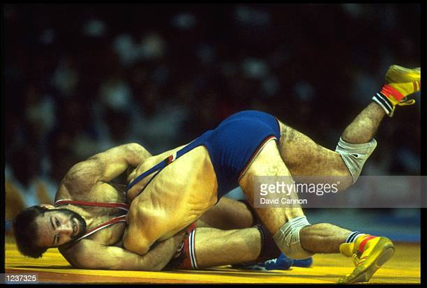 DAVID SCHULTZ OF THE UNITED STATES IN ACTION AGAINST MARTIN KNOSP OF GERMANY IN THE 74KG WELTERWEIGHT FREESTYLE WRESTLING COMPETITION AT THE 1984 LOS...