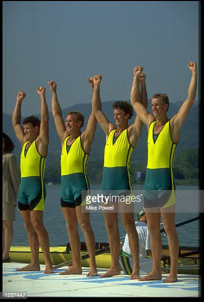 ANDREW COOPER MICHAEL MCKAY NICHOLAS GREEN AND JAMES TOMKINS OF AUSTRALIA THROW THEIR ARMS IN THE AIR TO CELEBRATE THEIR VICTORY IN THE MENS FOUR...
