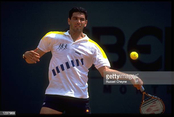 ANDRES GOMEZ OF ECUADOR PLAYS A BACKHAND STROKE DURING A MATCH AT THE 1990 MONTE CARLO OPEN