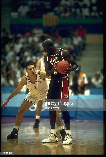 MICHAEL JORDAN OF THE UNITED STATES HOLDS THE BALL FROM DRAZEN PETROVIC OF CROATIA DURING THE FINAL OF THE BASKETBALL TOURNAMENT AT THE 1992...