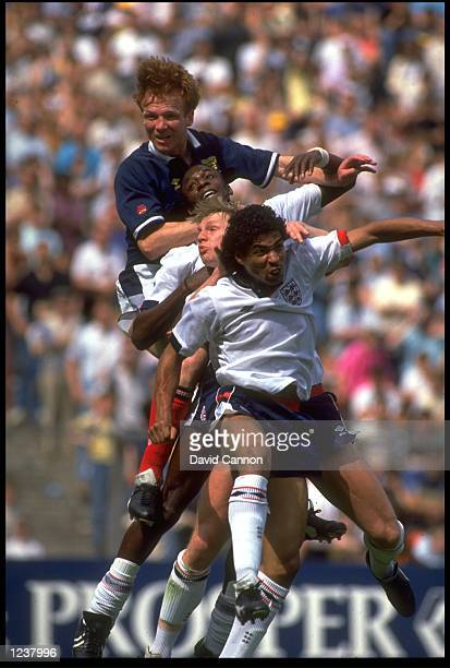 ALEX MCLEISH OF SCOTLAND LEAPS ABOVE THREE ENGLAND PLAYERS TO HEADER THE BALL DURING THE 1989 ROUS CUP PLAYED IN HAMPDEN PARK IN SCOTLAND ENGLAND WON...