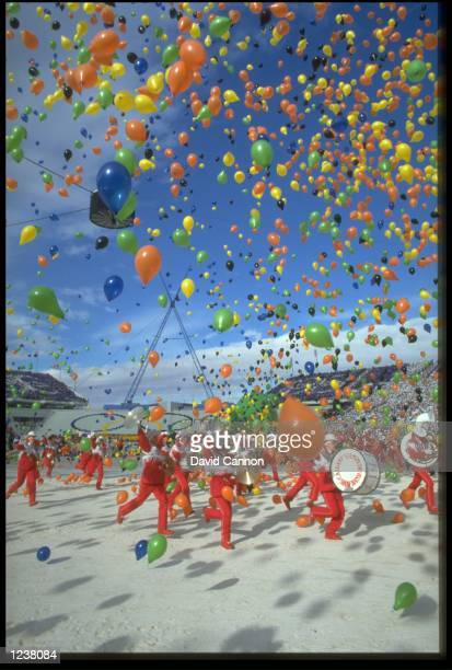 THE BAND RUN THROUGH A CLUSTER OF BALLOONS DURING THE OPENING CEREMONY OF THE 1988 WINTER OLYMPICS HELD IN CALGARY