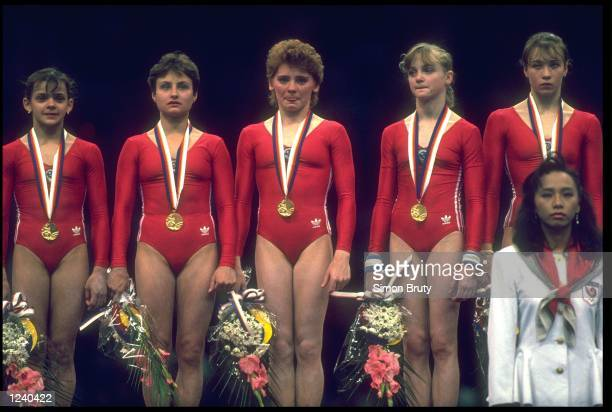 THE GYMNASTICS TEAM FROM THE SOVIET UNION CELEBRATE AFTER WINNING THE GOLD MEDAL IN THE COMBINED TEAM EVENT AT THE 1988 SEOUL OLYMPICS