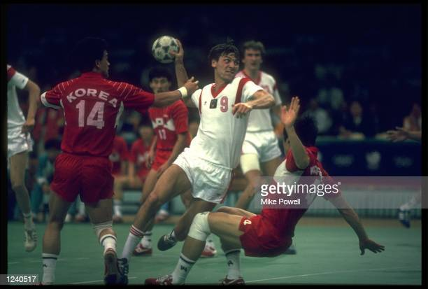 A SOVIET PLAYER ATTEMPTS A SHOT DURING THE FINAL OF THE MENS TEAM HANDBALL COMPETITION AT THE 1988 SEOUL OLYMPICS THE SOVIET UNION WON THE MATCH 3225