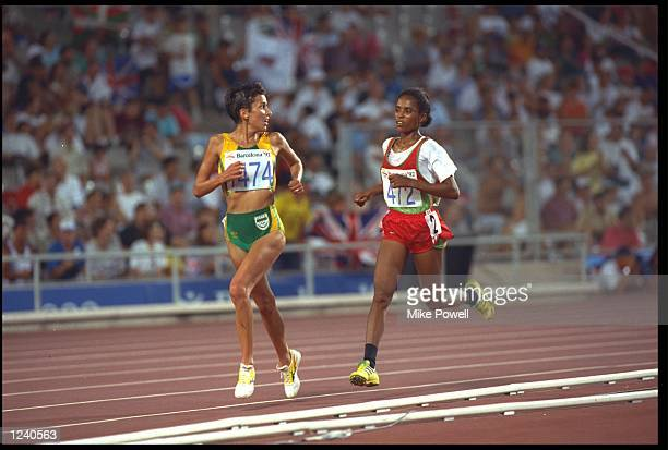 ELANA MEYER OF SOUTH AFRICA IS PURSUED BY DERARTU TULU OF ETHIOPIA DURING THE FINAL OF THE WOMENS 10000 METRE AT THE 1992 BARCELONA OLYMPICS TULU WON...