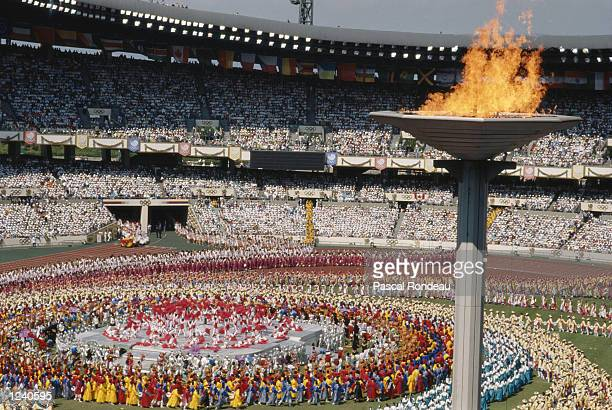 DANCERS PERFORM IN THE CENTRE OF THE STADIUM DURING THE OPENING CEREMONY OF THE 1988 SUMMER OLYMPICS HELD IN SEOUL IN SOUTH KOREA.