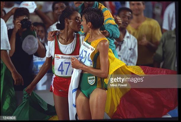 DETARTU TULU OF ETHIOPIA AND ELANA MEYER OF SOUTH AFRICA CELEBRATE AFTER CLAIMING FIRST AND SECOND IN THE WOMENS 10000 METRE FINAL AT THE 1992...