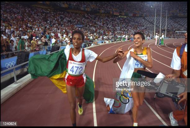 DERARTU TULU OF ETHIOPIA AND ELANA MEYER OF SOUTH AFRICA RUN A LAP OF HONOUR AFTER CLAIMING FIRST AND SECOND PLACE IN THE WOMENS 10000 METRE FINAL AT...