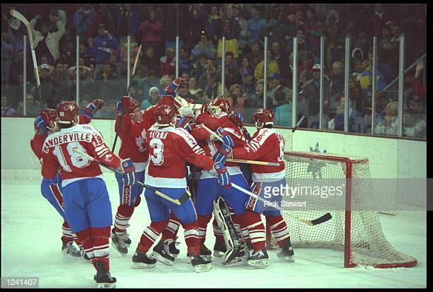 CANADA CELEBRATE AFTER DEFEATING GERMANY IN A SKATE OFF DURING THE ELIMINATION ROUND OF THE ICE HOCKEY TOURNAMENT AT THE 1992 WINTER OLYMPICS IN...