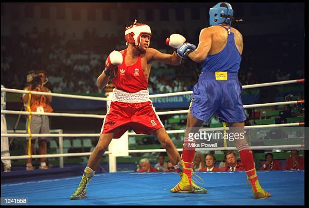 OSCAR DE LA HOYA OF THE UNITED STATES PREPARES TO THROW A PUNCH DURING HIS BOUT AGAINST ADILSON SILVA OF BRAZIL IN THE LIGHTWEIGHT BOXING TOURNAMENT...