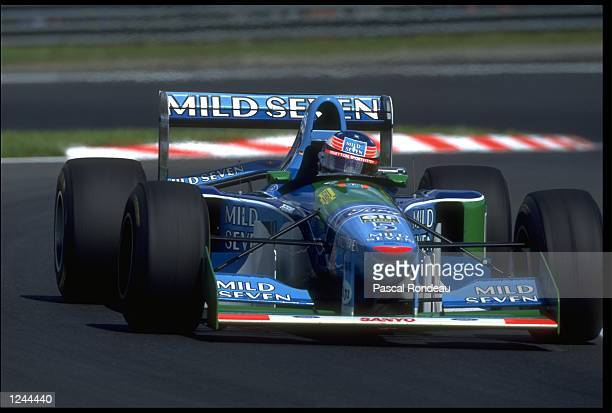 MICHAEL SCHUMACHER OF GERMANY COMES OUT OF A RIGHT HAND BEND IN HIS BENETTON FORD DURING THE BELGIUM GRAND PRIX AT THE CIRCUIT DE SPA FRANCORCHAMPS...