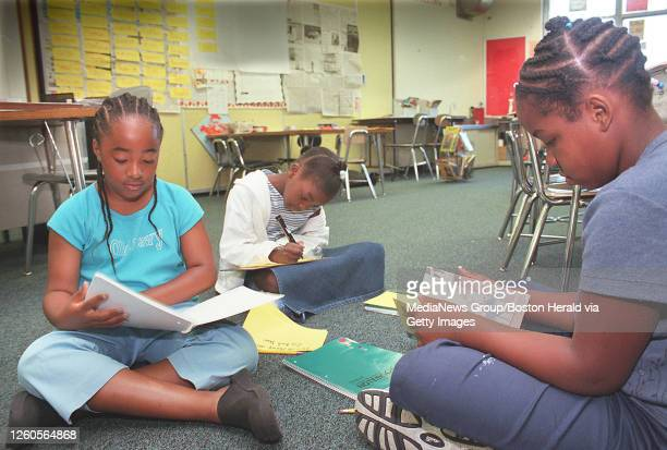 DORCHESTER, MA 7/20/2000: SUMMER SCHOOL PROGRAM AT THE LEE SCHOOL. FROM LEFT: TAKIA RUSSELL KORNILIA FLOYD, 8 AND RACHEL HILL WORK ON A MATRIX...