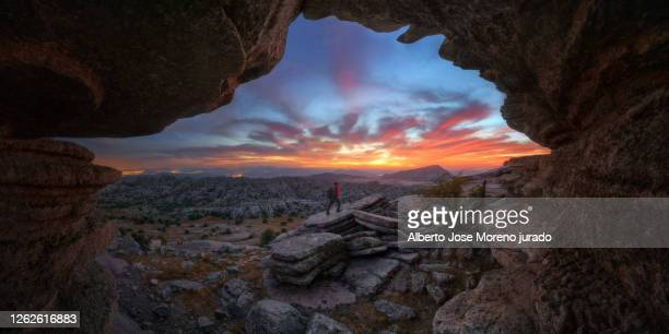 sunset in a beautiful landscape with person and orange clouds - andalucia stock pictures, royalty-free photos & images