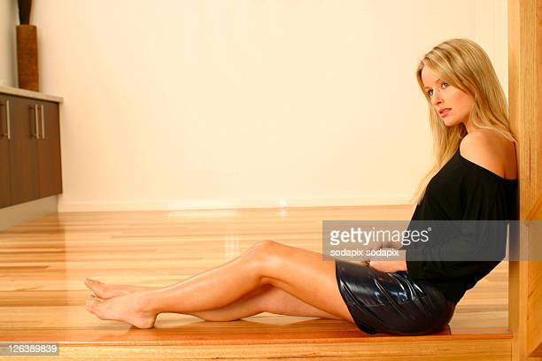 - - legs and short skirt sitting down stock photos and pictures