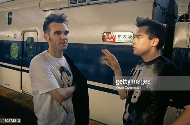 English singer and lyricist Morrissey with guitarist Boz Boorer at a railway station in Japan during Morrissey's Kill Uncle Tour August September 1991